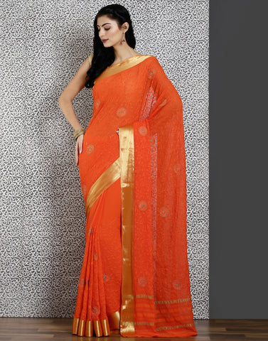 Orange colour woven saree with self design golden detailing