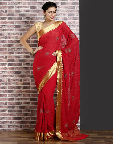 Hot-pink colour woven saree with self design golden detailing