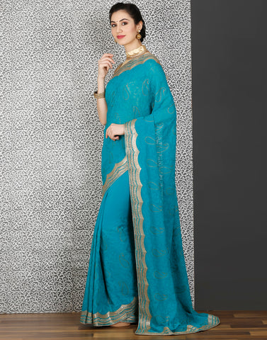 Meena Bazaar:Lake-blue colour saree with embroidery-stone work