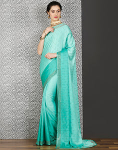 Meena Bazaar:Sea-green colour georgette saree with stone work