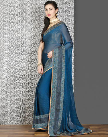Meena Bazaar:Georgette saree with stone work in peacock-blue colour