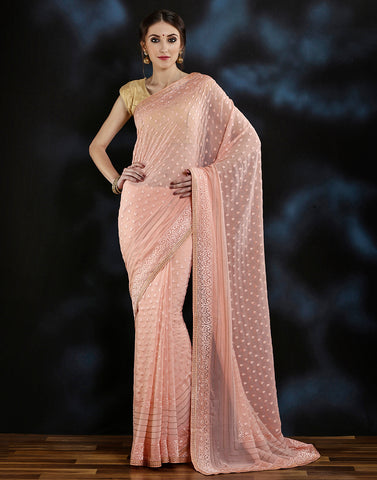 Meena bazaar:  Stonework saree with woven booties