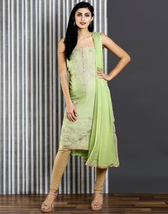 Meena Bazaar : Green colour unstitched suit set with golden embroidery.