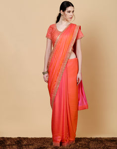 Meena Bazaar: Orange dupion silk saree with embroidered work