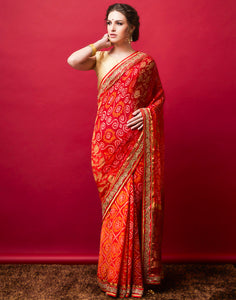 Orange Maroon Georgette Embroidered Saree