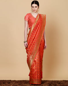 Meena bazaar: Banarsi handloom silk saree in orange colour