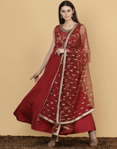 Anarkali style suit with golden embroidery