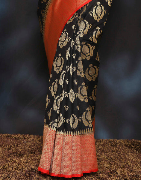 Woven saree with golden floral booties and contrasting border