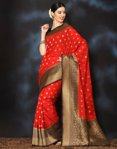 Meena Bazaar:  Woven saree with golden floral booties with contrasting border