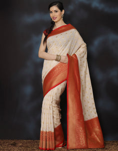 Woven saree with golden floral booties with contrasting border