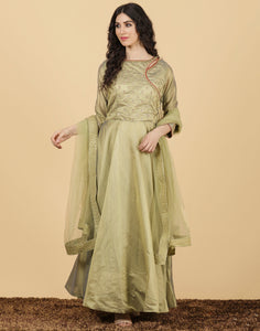 GREEN Long suit with golden embroidery