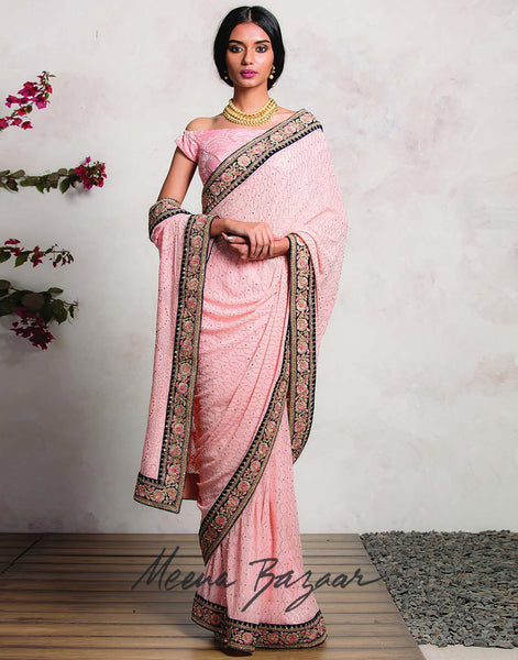 Meena Bazaar:Peach colour  pure Georgette Saree