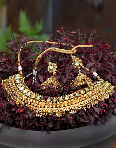 Meena Bazaar: Golden necklace with gems and meenakari work