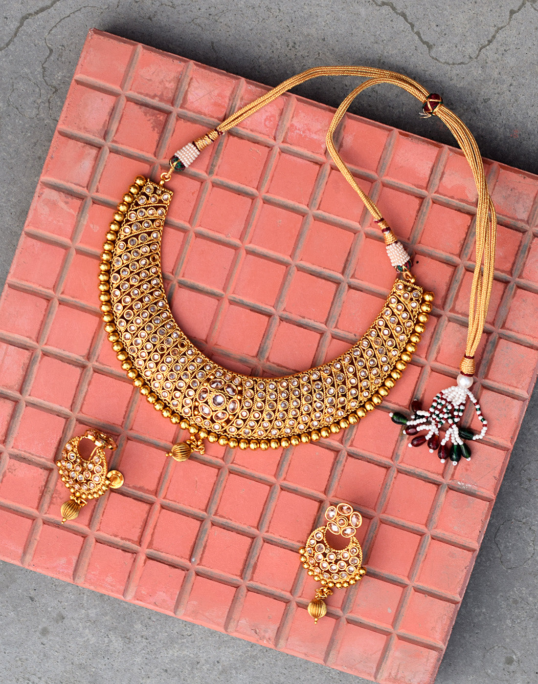 Meena Bazaar: Golden neck-piece with gemstone work