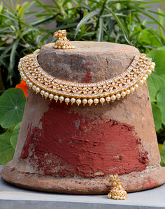 Meena Bazaar: Golden neck-piece with gemstone and cut work