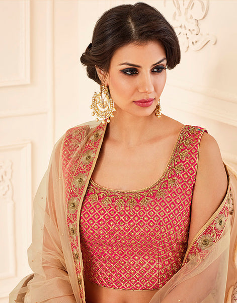 Meena Bazaar:  Dupion silk laacha set in rani colour with net dupatta