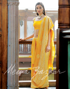 Yellow colour woven saree on georgette fabric