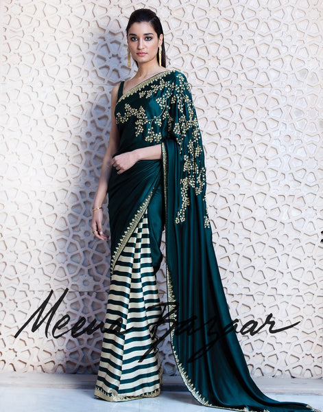 Satin saree with floral embroidery.