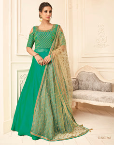 Meena Bazaar: Green colour embroidered floor length Anarkali with a self-design net dupatta