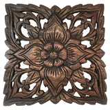 small carved wood plaque