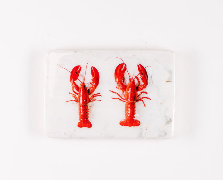 Two cooked canner lobsters on ice (29cm x 20cm)
