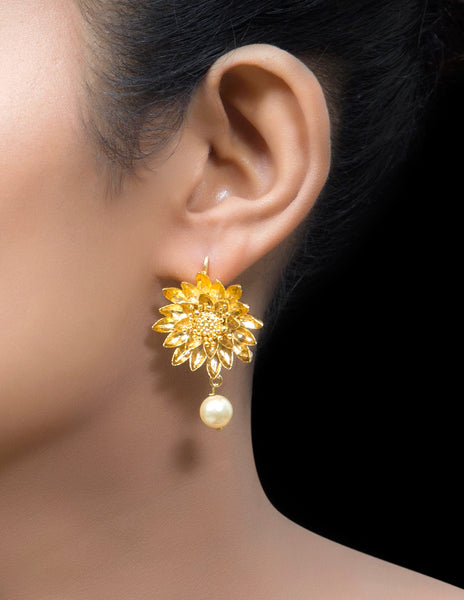 Gold tone flower earring with ruby drop