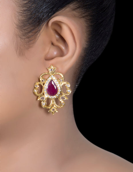 Dazzling ruby swirl earrings