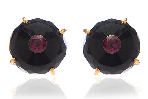 Silver onyx stud earrings with a ruby centre