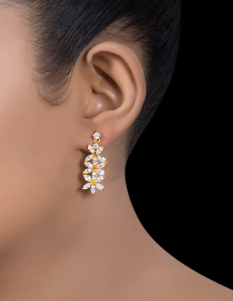 Gold tone silver zirconia leaf drop earrings