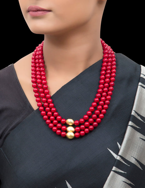 Red coral multi string necklace