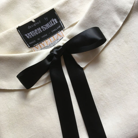 1980's ivory retro top with black ribbon neck ties by Vivien Smith