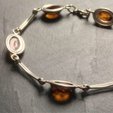 Vintage Baltic amber bracelet set in a silver chain. Christmas gift.