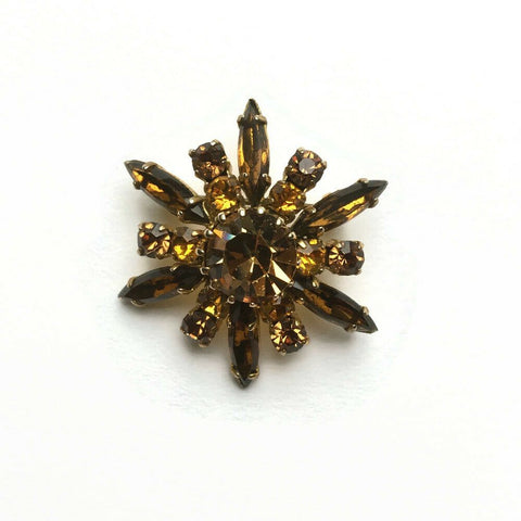Vintage 1950's Czech glass brooch in a starburst design of honey amber.