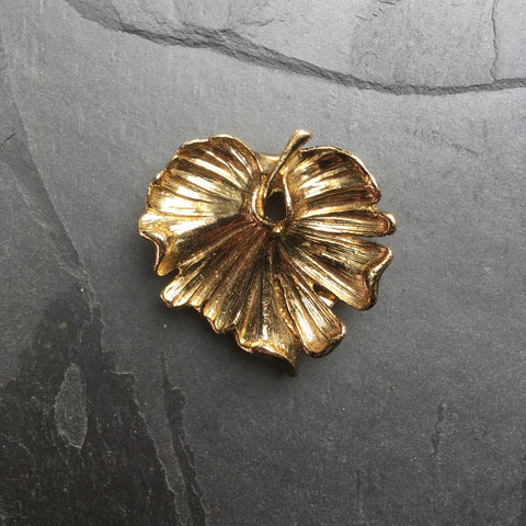 vintage scarf clip in a gold leaf shape by hurdyburdy vintage