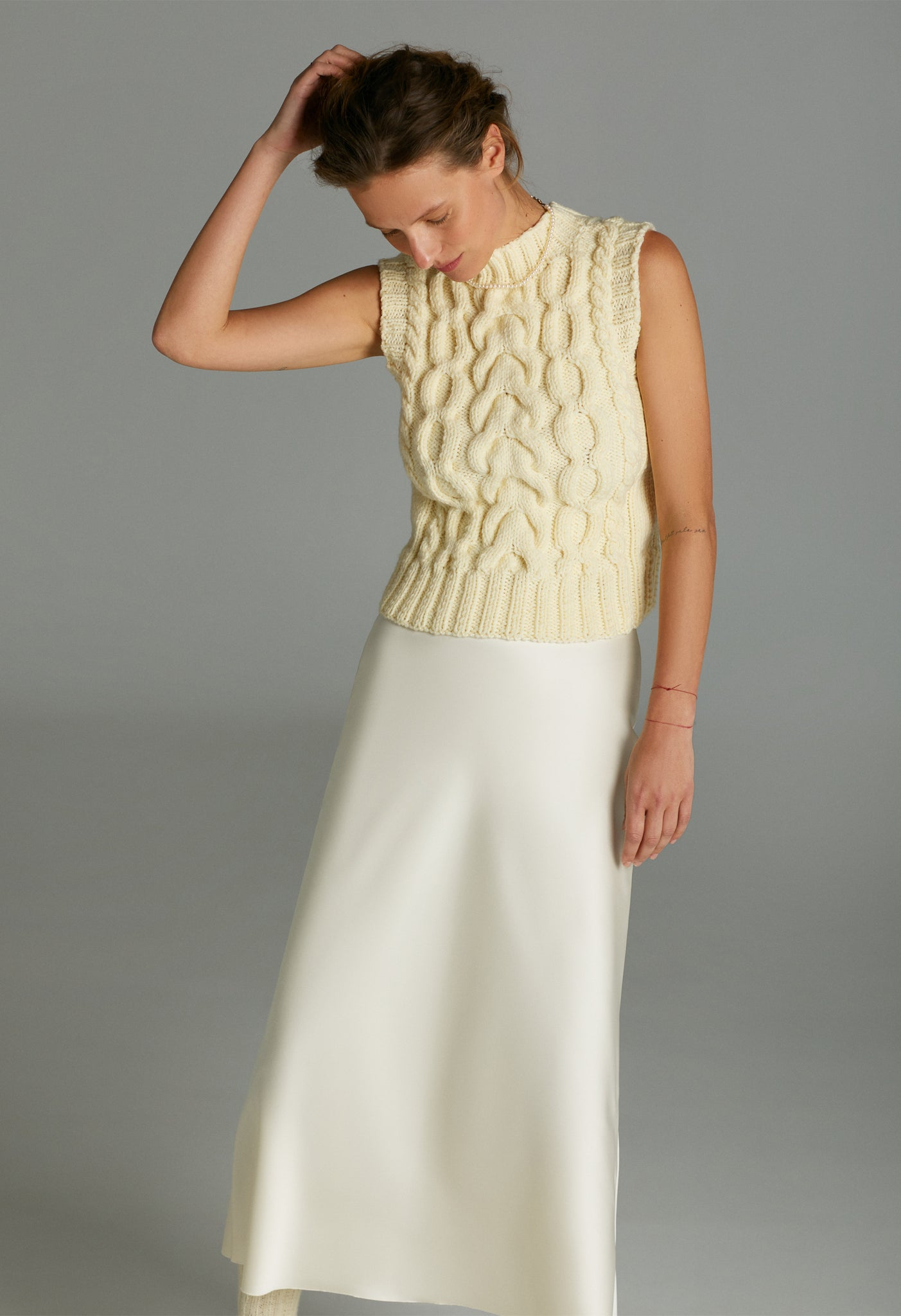 Model in Cream hand knitted vest