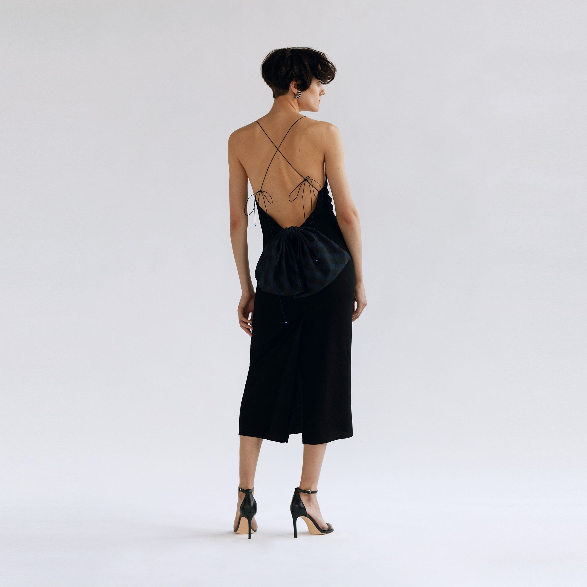 Model in 'Jerry Hall' dress, back view.