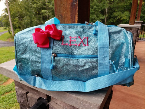 large turquoise glitter duffel