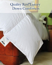 Down comforter draped over bed