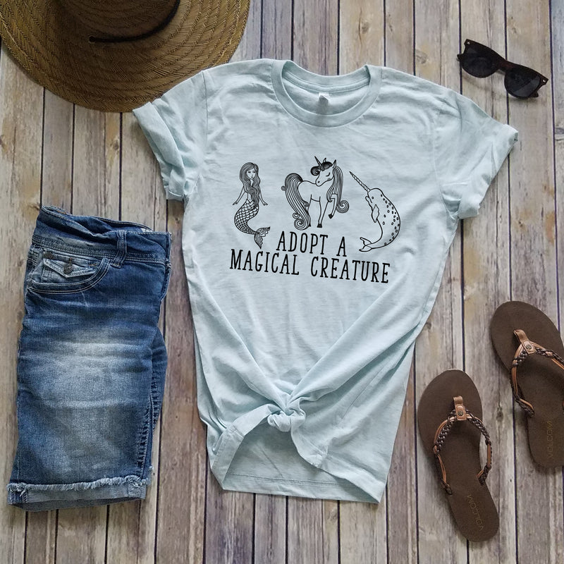 Adopt a magical creature ice blue unisex tee shirt
