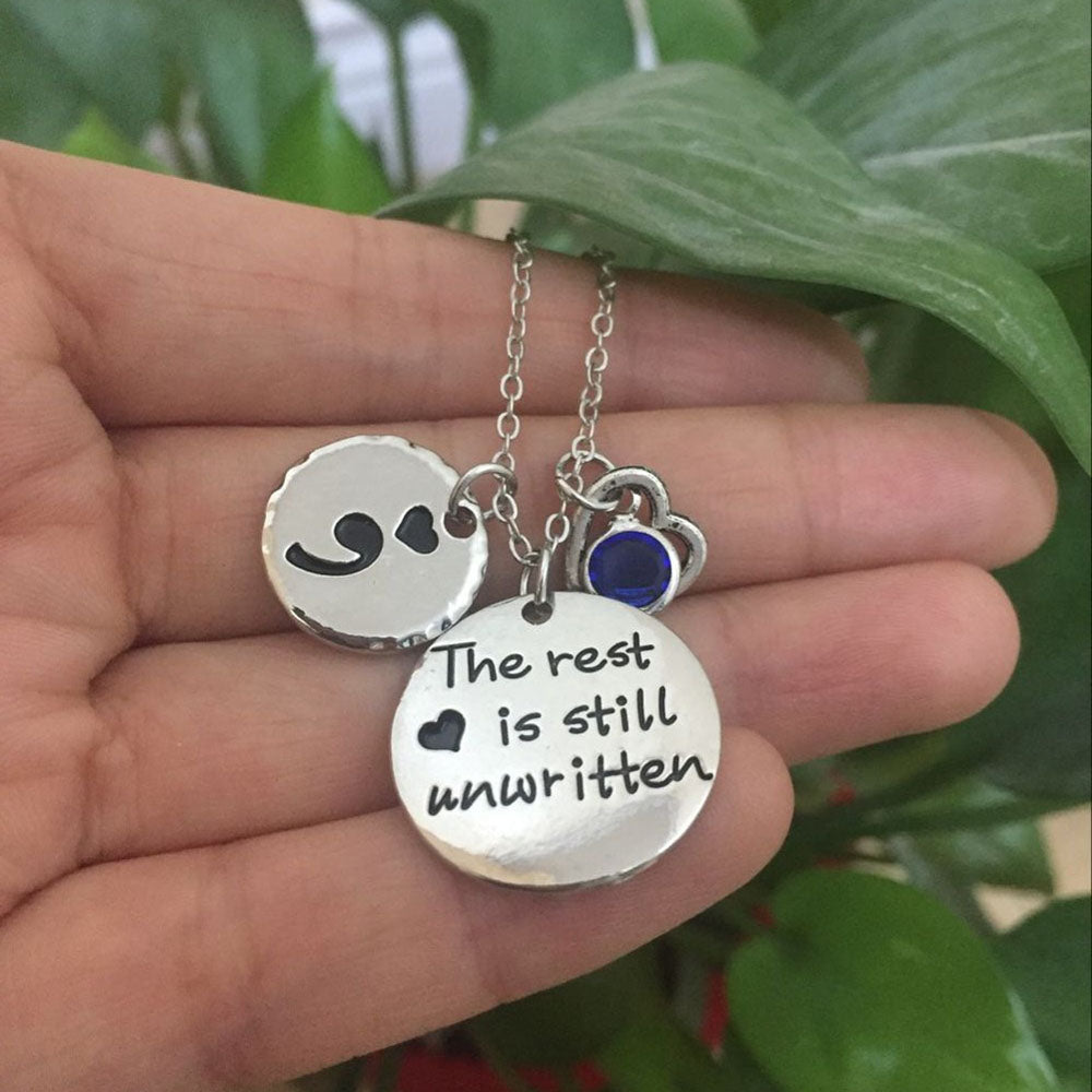 """The Rest Is Still Unwritten"" Semicolon Necklace with Birthstone - Charmora.com"