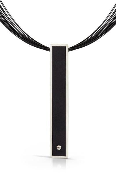 Contemporary, art jewelry, stainless steel cord necklace with black LEGO bar pendant with diamond