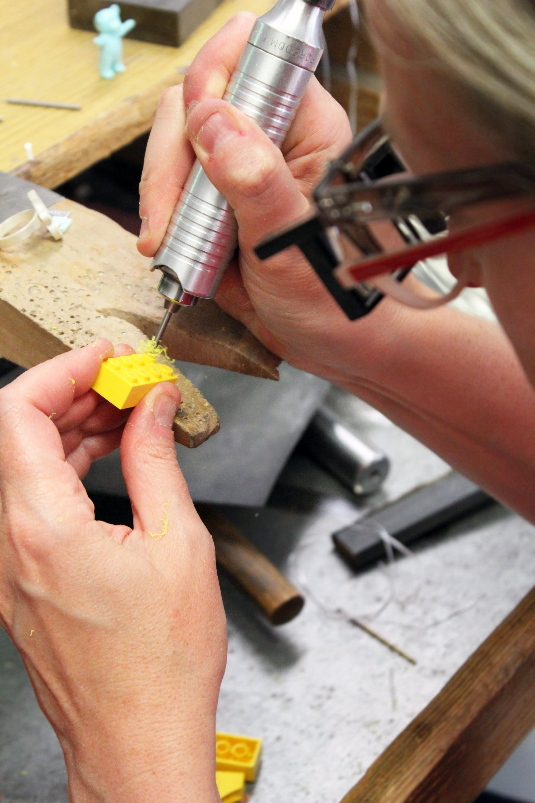 LEGO Designer drilling into a LEGO fabricated jewelry from LEGO