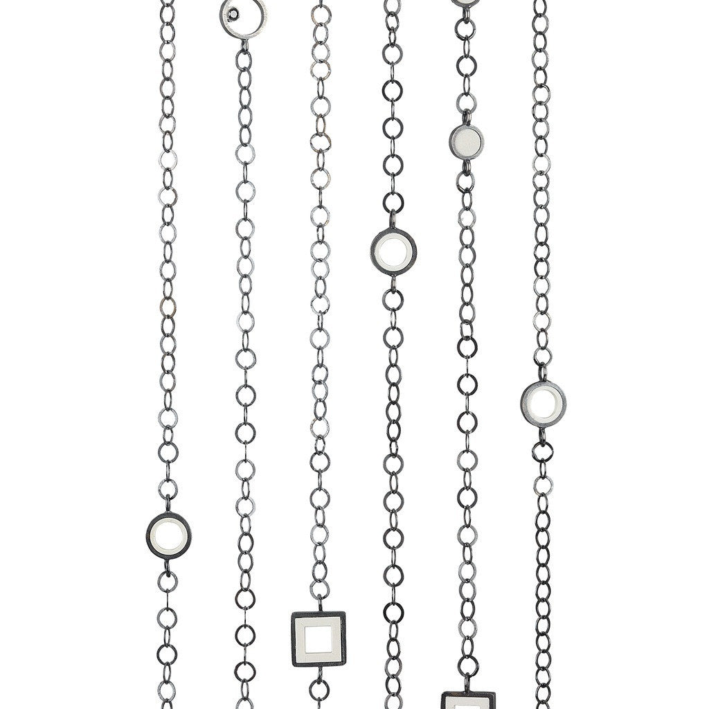 Sterling silver necklace strands with fun LEGO pieces