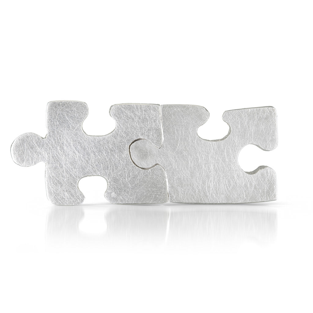Autism Awareness sterling silver puzzle piece earrings that fit together