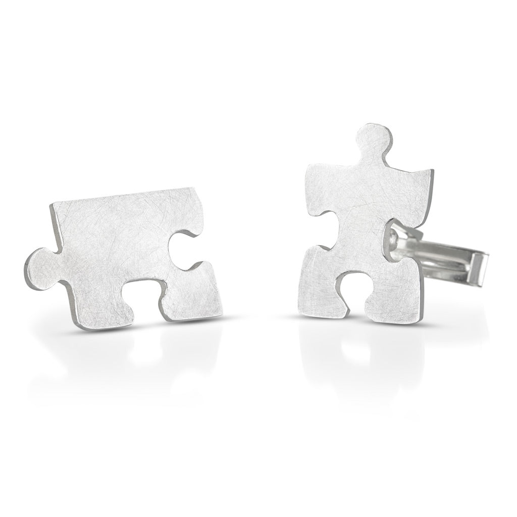 Autism awareness puzzle piece cuff links shown apart