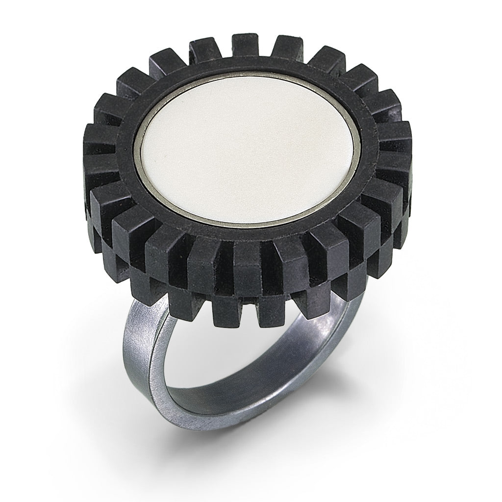 recycled LEGO truck tire made into a contemporary modern ring with white round LEGO tile in center