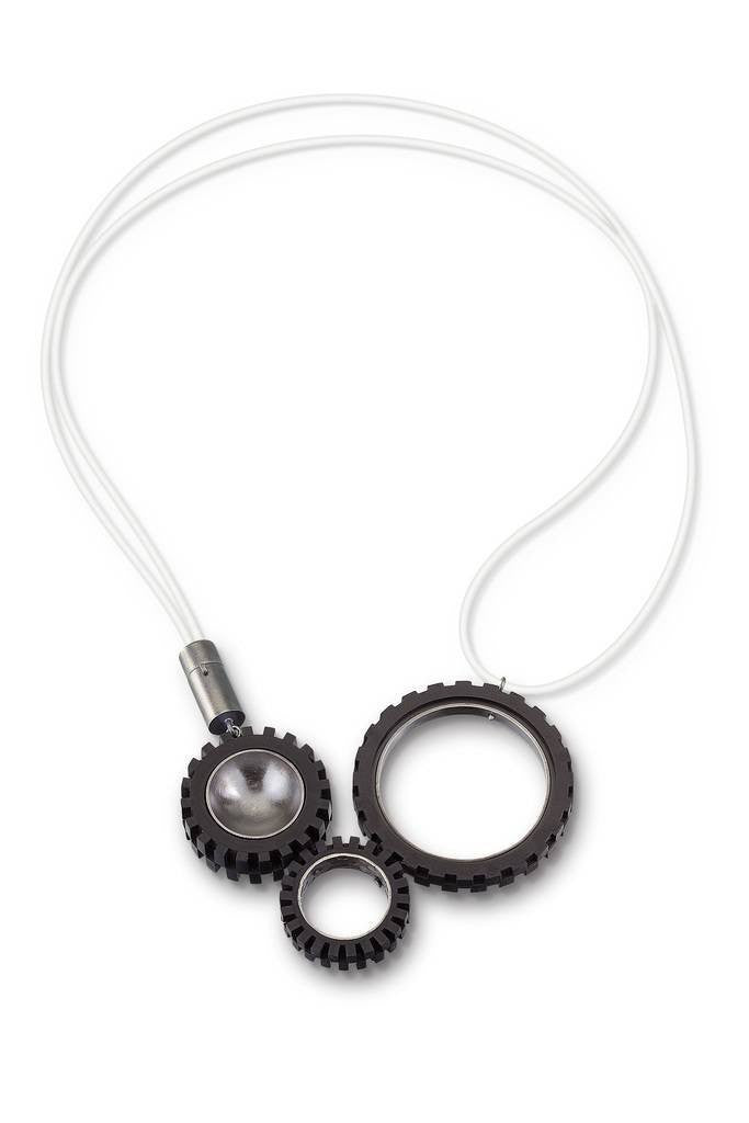 Funky necklace with 3 LEGO Truck tires with hand fabricated sterling silver tube clasp