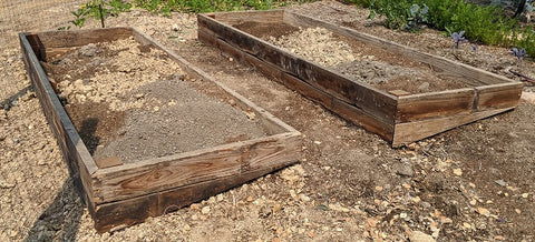 two raised beds filled with compost soil