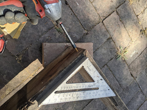 measuring your raised bed using electric drill and ruler