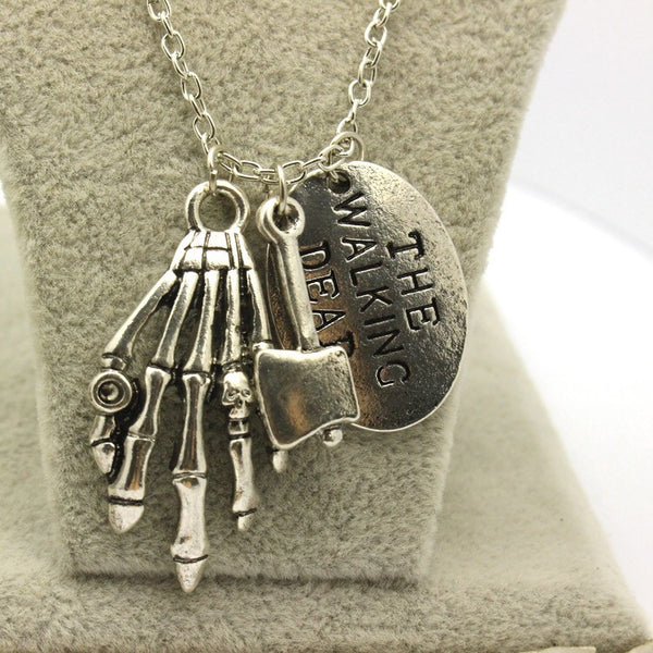 A Walking Dead Axe and Zomie hand Necklace